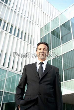 portrait of businessman outside offices
