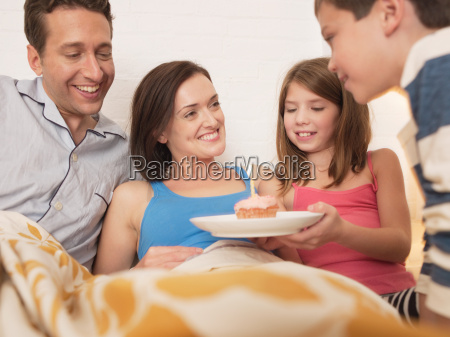 mid adult woman receiving birthday cake