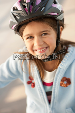 girl wearing bike helmet outdoors