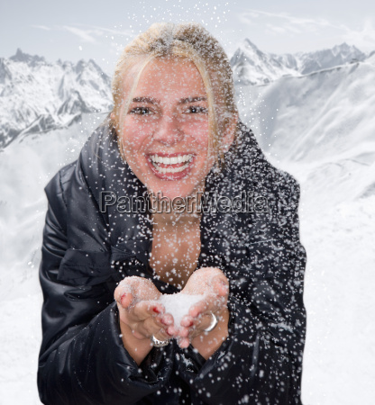 young woman smiles with snow