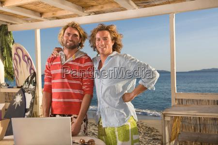portrait young men at beach house