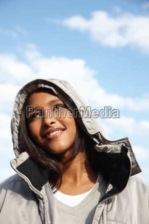 woman wearing hooded jacket outdoors
