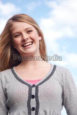woman smiling enjoying the outdoors