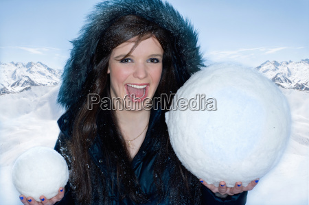 young, happy, woman, with, two, snowballs - 19463484