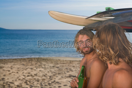 surf boys with beer at beach