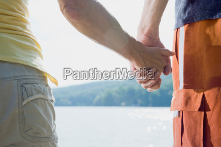 holding hands of a couple