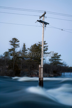 electricity pole submerged by flood