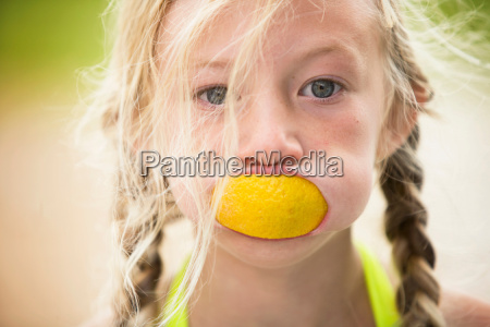 young girl with orange peel in