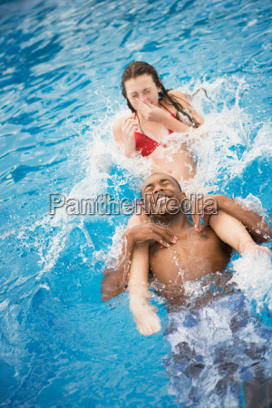 teen boy and girl playing in