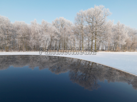 winter landscape reflecting in car roof