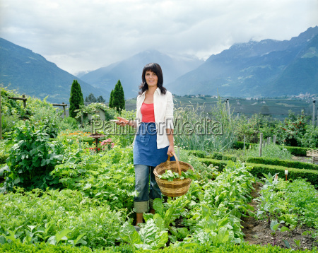 woman in her garden with vegetables