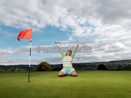 mature lady winning at golf