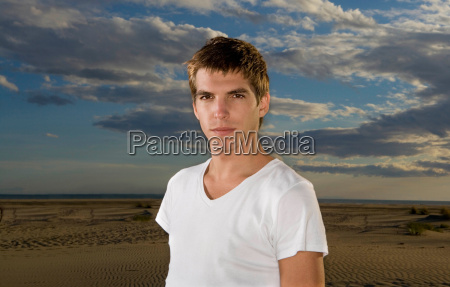 young man portrait at beach