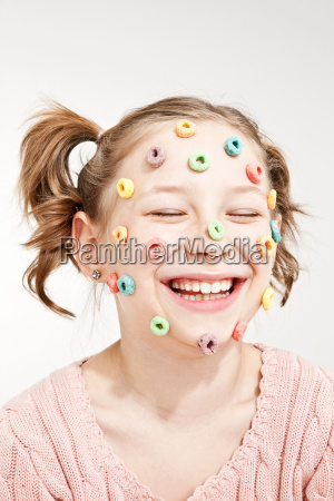 girl with breakfast cereal covering face