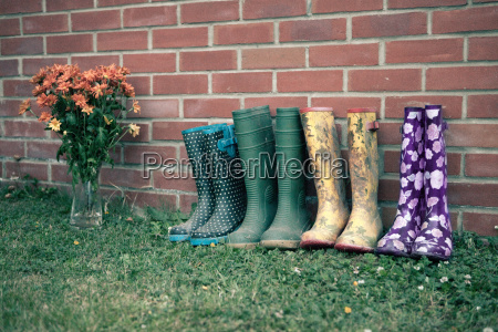 wellington boots by brick wall