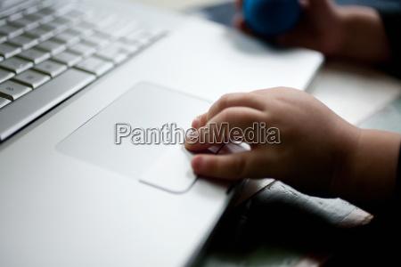 toddler using laptop close up