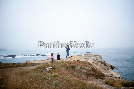 family looking at view of coast
