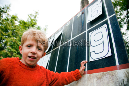 young boy playing with numbers on