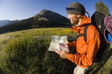 man hiking near big sandy lake
