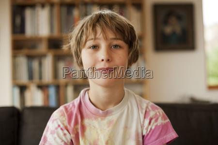 boy at home looking at camera