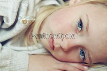 young girl lying on side close