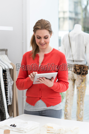 young female using digital tablet in