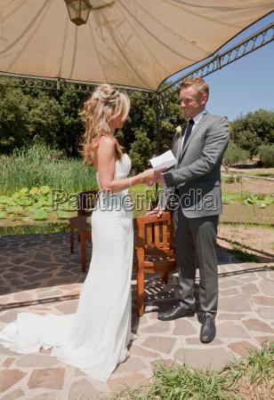 mid adult couple on wedding day