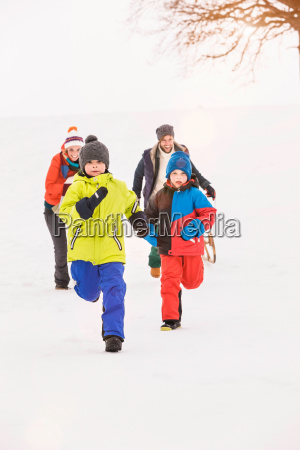 family running in snow