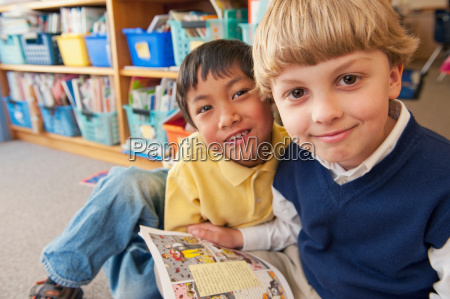 students reading book together