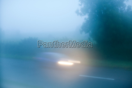 car driving in fog down country
