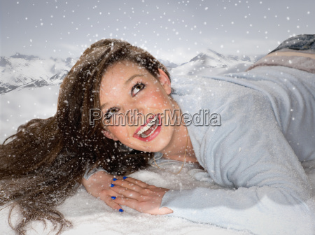 young woman looks up at falling