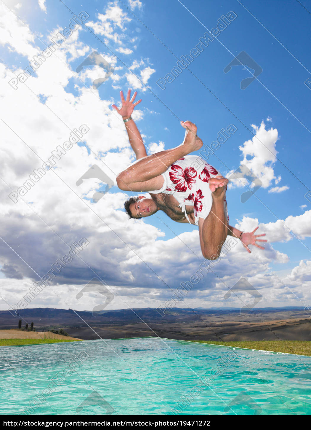 man, jumping, in, swimming, pool - 19471272
