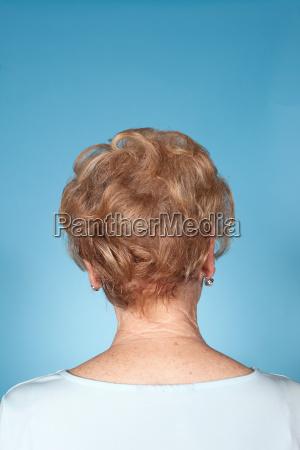 senior woman rear view studio shot