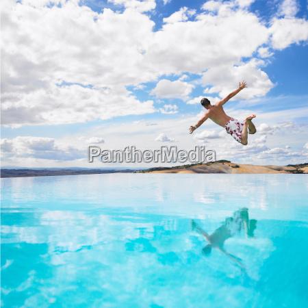 man, jumping, in, swimming, pool - 19474878