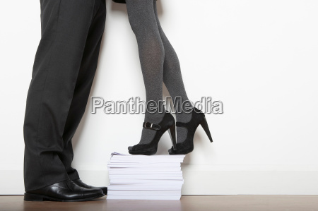 business woman on paper pile