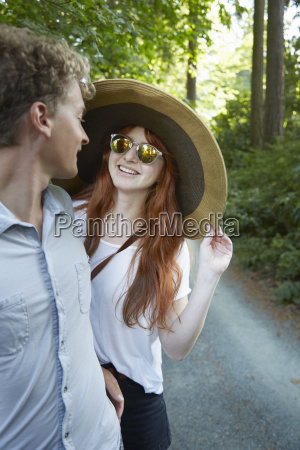 young couple chatting on forest road