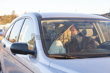 view through windscreen of young couple