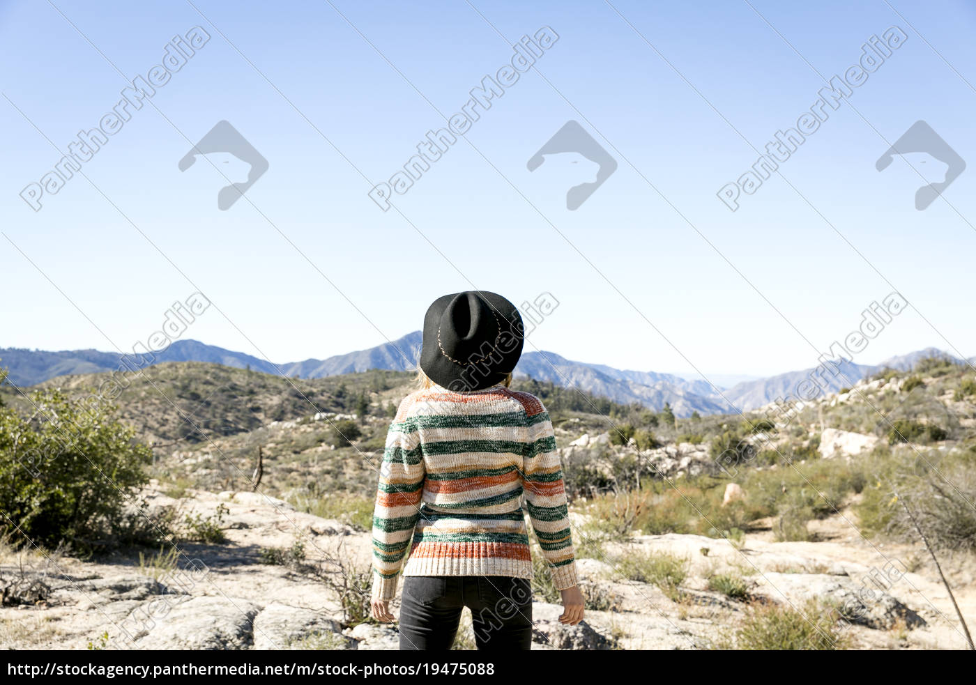 rear, view, of, young, woman, wearing - 19475088