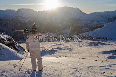 skier looking over alpe dhuez