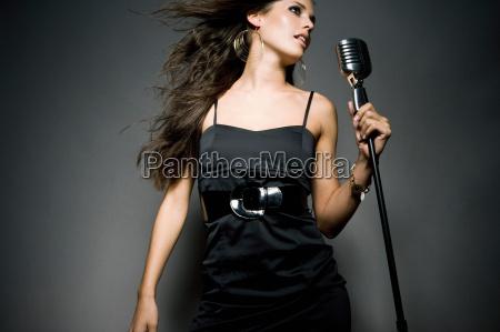 woman dancing next to mic
