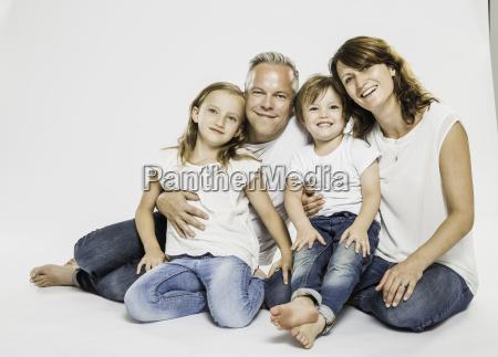studio portrait of parents sitting on