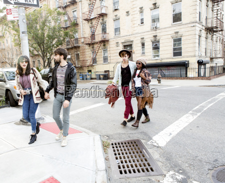 two young hipster couples crossing city