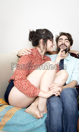 young hipster couple sitting on apartment