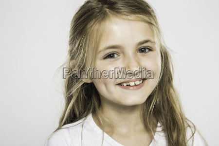 studio portrait of happy girl with