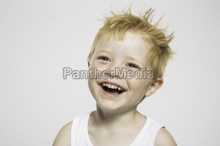 studio portrait of cute boy with