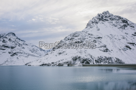 silvretta reservoir and snow covered mountain