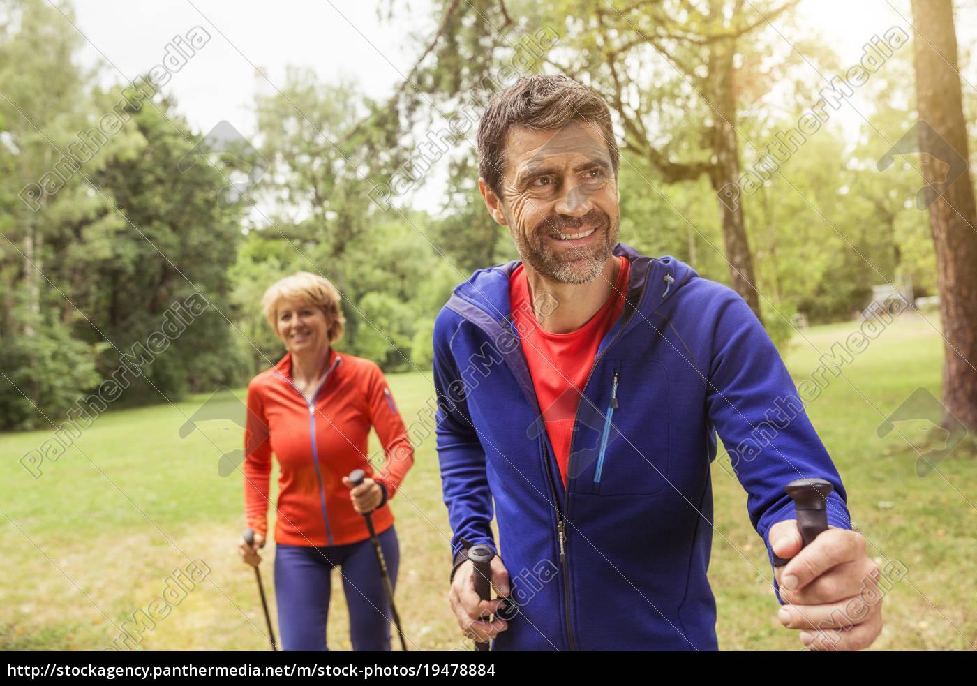 couple, walking, outdoors, , using, walking, poles - 19478884