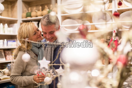 mature couple browsing snowflake decorations in