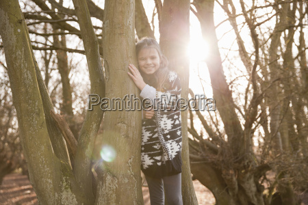 portrait of girl standing in sunlit
