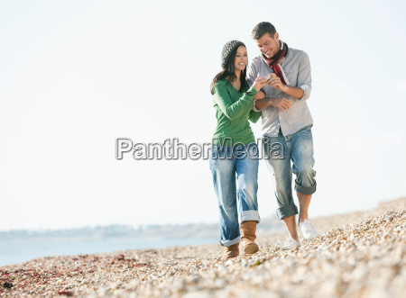 young couple strolling on beach